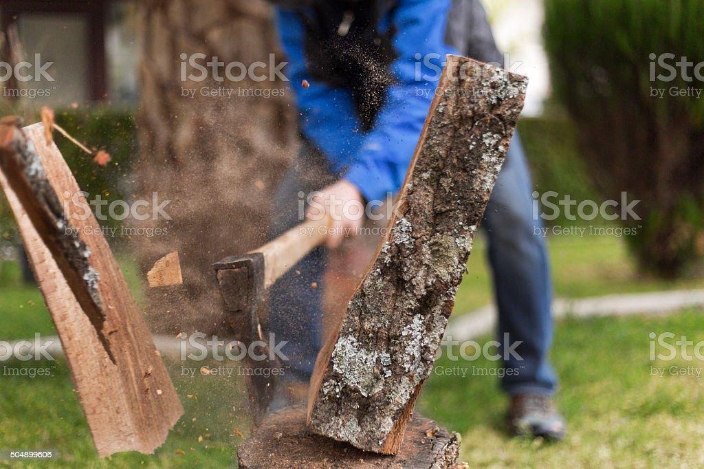Man cutting wood stock photo