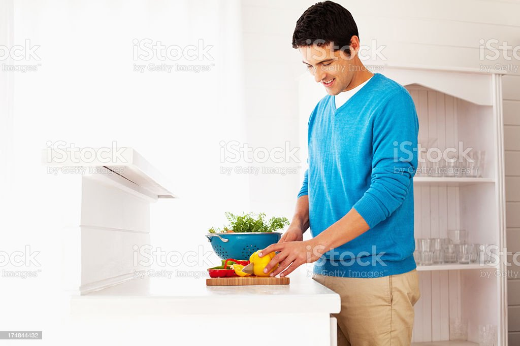 Man Cutting Yellow Bell Pepper royalty-free stock photo