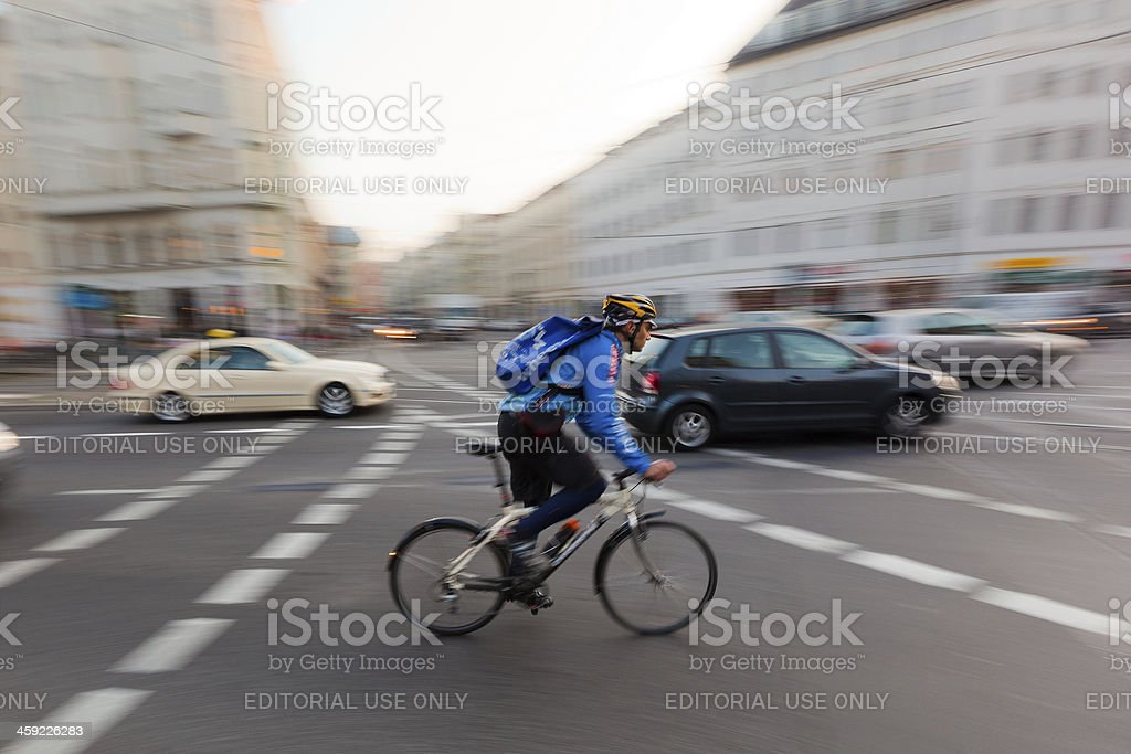 Man Cycling in Berlin, Panning royalty-free stock photo
