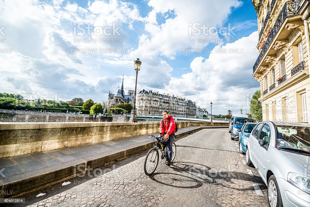 Man cycling in Paris, France stock photo
