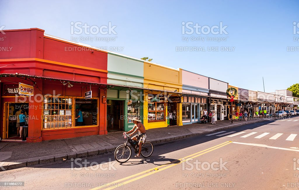 Man cycling on Lahaina shopping street, Maui stock photo
