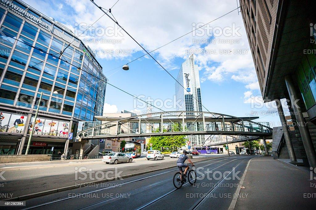 Man cycling on Oslo street stock photo