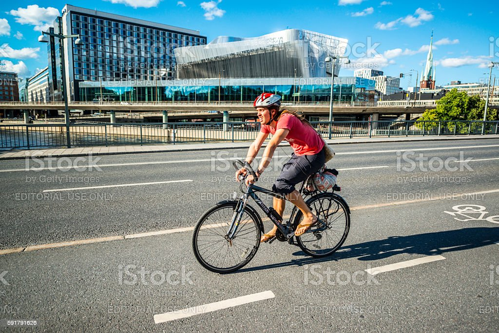 Man cycling on Stockholm street, Sweden stock photo