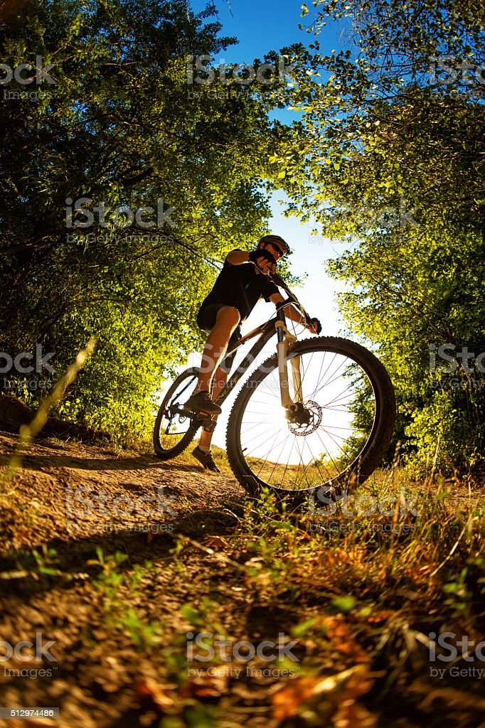 Man Cyclist with bike on sunset stock photo