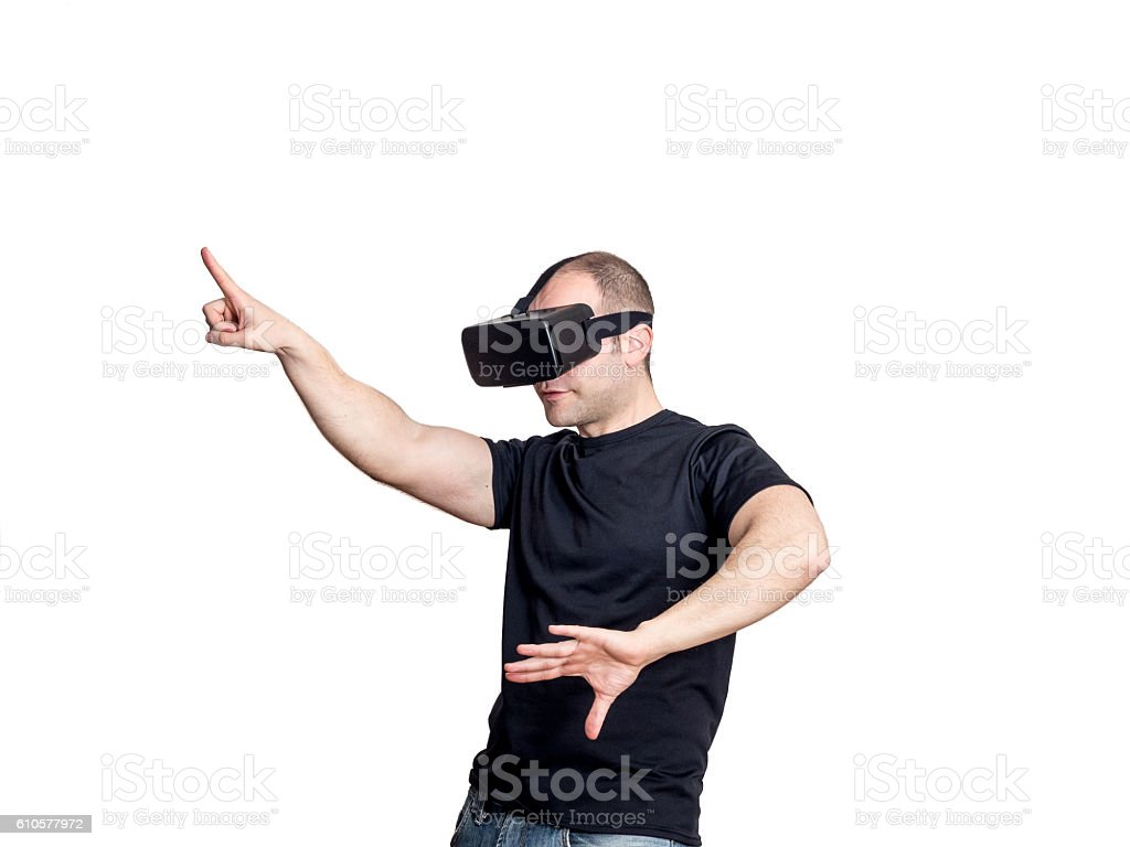Man dancing and having fun with virtual reality headset. stock photo