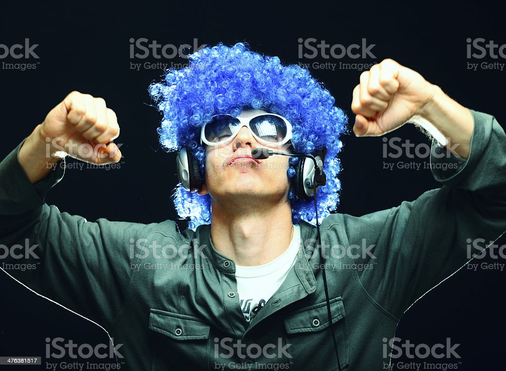 DJ man dancing and listening to music royalty-free stock photo