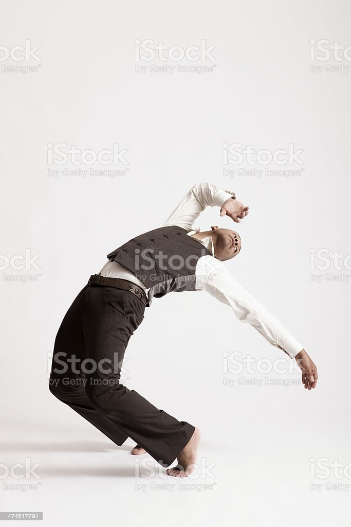 Man Dancing Jazz Over White Background stock photo