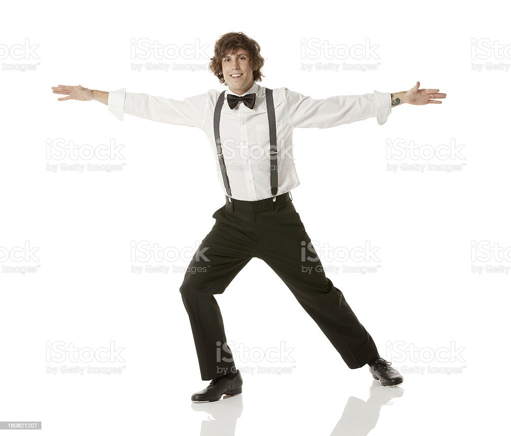 Man dancing with his arms outstretched royalty-free stock photo