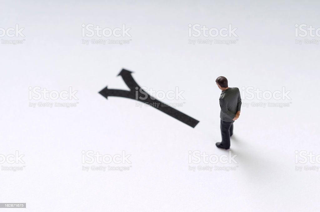 Man deciding which direction to take royalty-free stock photo