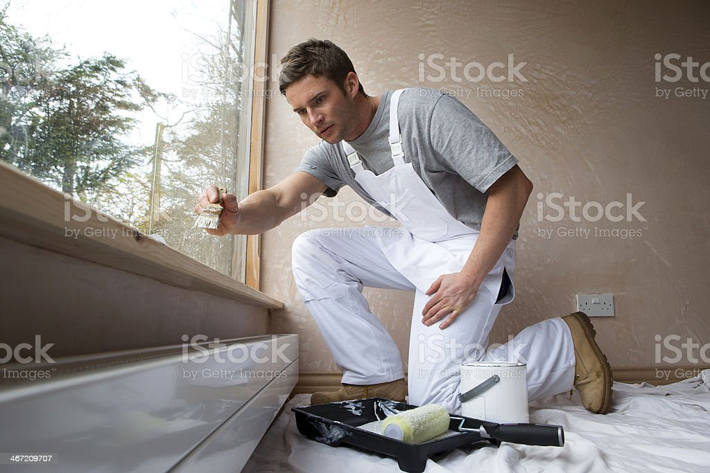 Man Decorating New Home stock photo