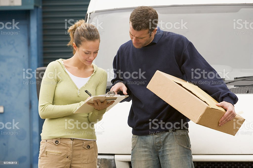 Man delivering parcel royalty-free stock photo
