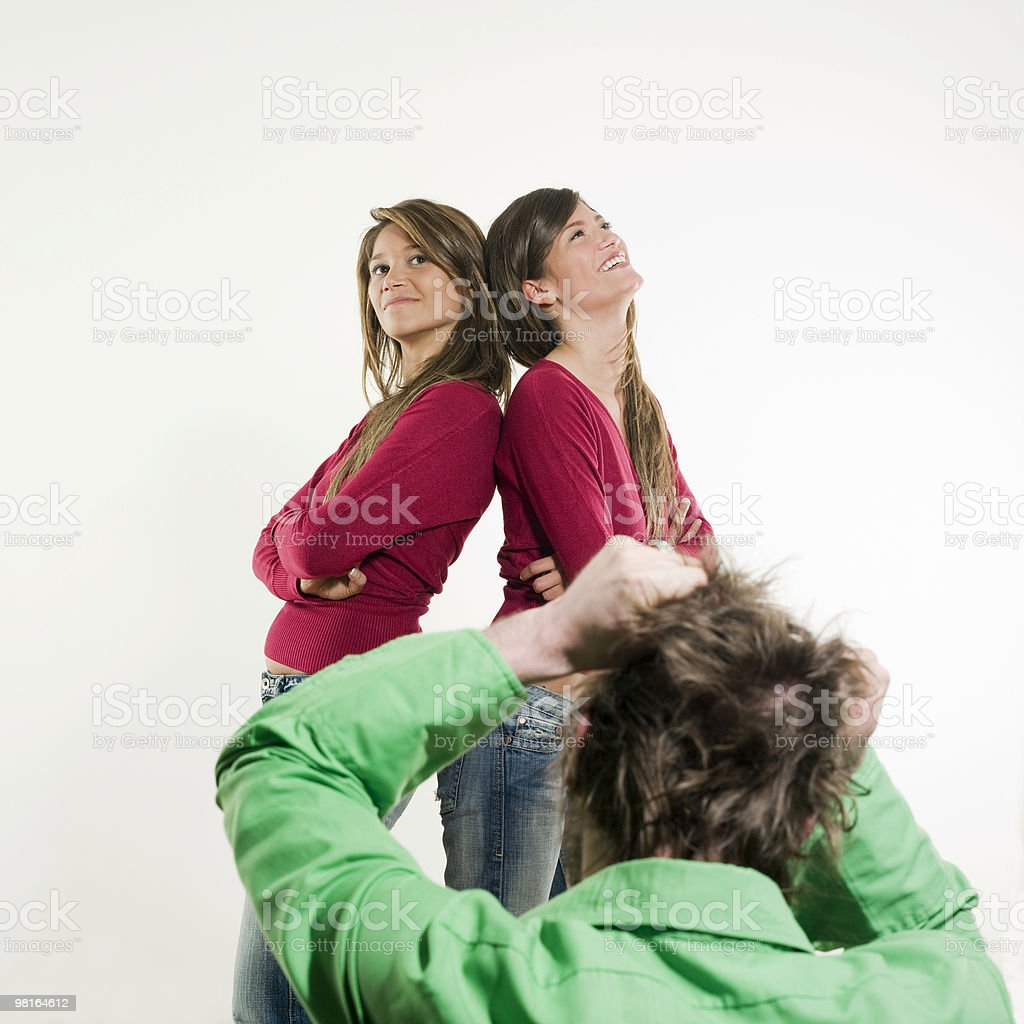 man despair to choose between two woman royalty-free stock photo