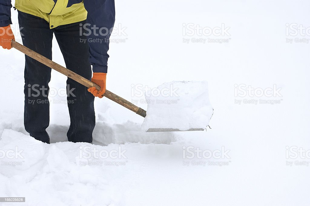Man digging a path from the snow royalty-free stock photo