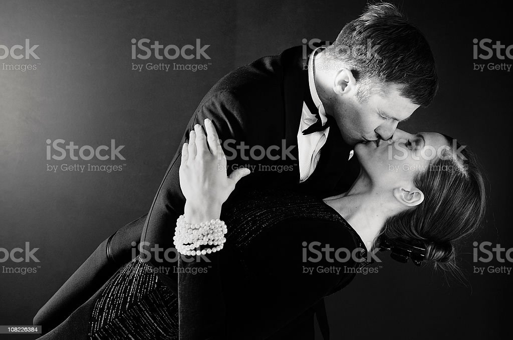 Man Dipping Woman and Kissing Her royalty-free stock photo