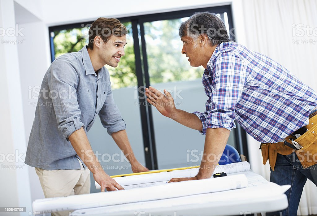 Man discussing with mature contractor royalty-free stock photo