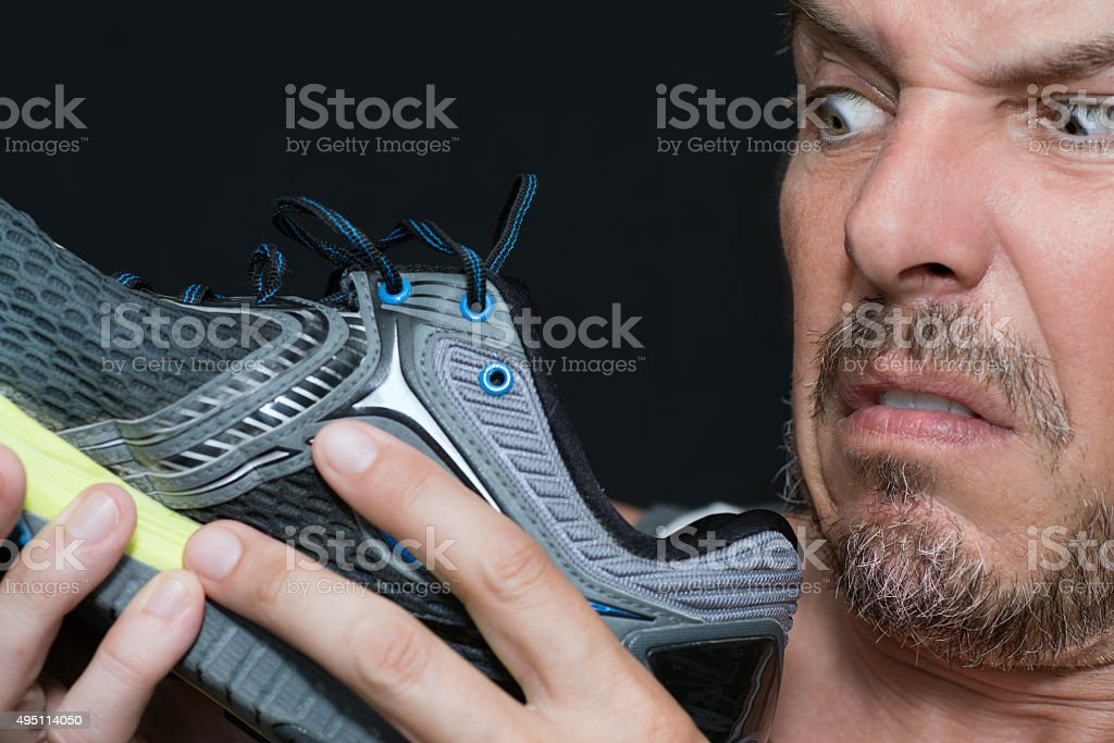 Man Disgusted By Shoes Smell stock photo
