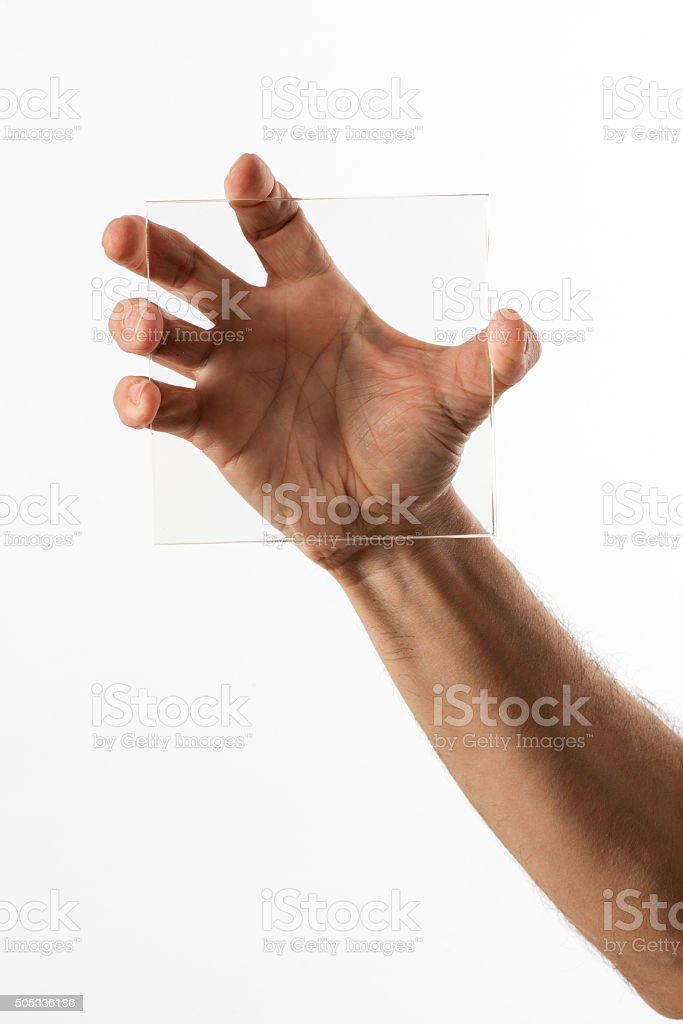 Man displaying a square of clear glass stock photo