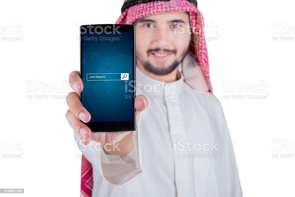 Man displaying job search box on cellphone stock photo