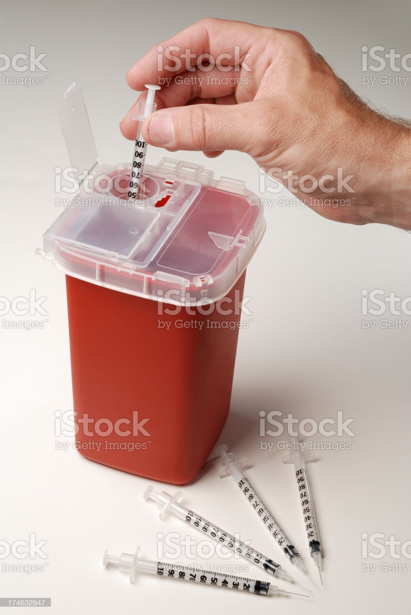 A man disposing a used syringe royalty-free stock photo