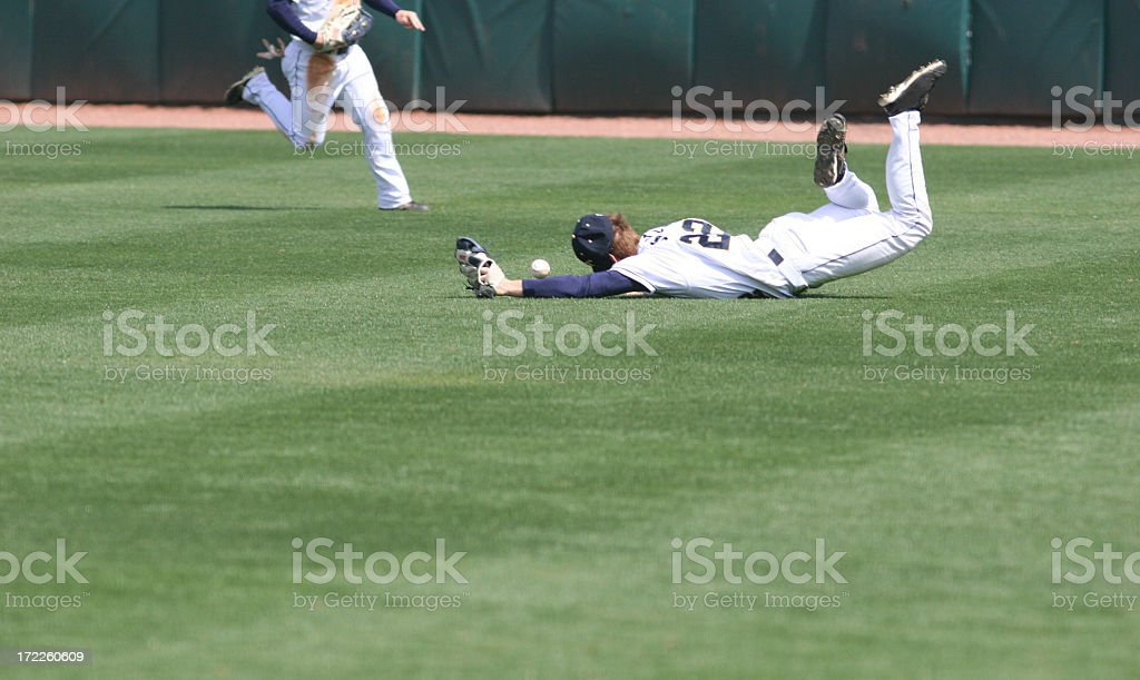 Man diving and missing the catch in baseball royalty-free stock photo