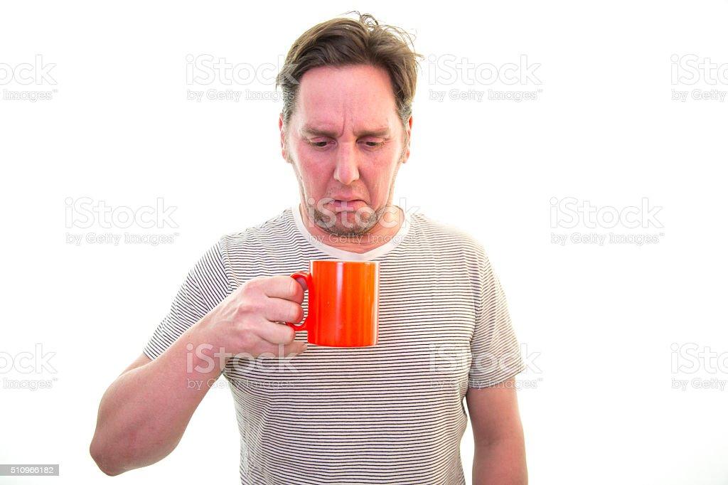 Man does not like his coffee/tea stock photo