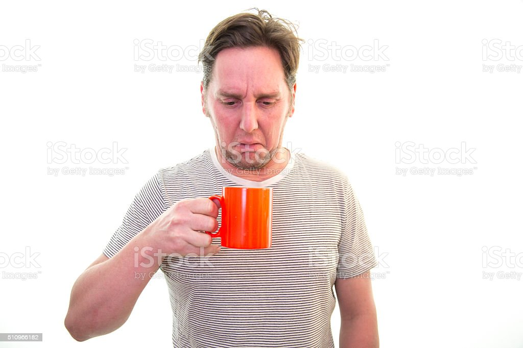 Man does not like his coffee/tea stock photo