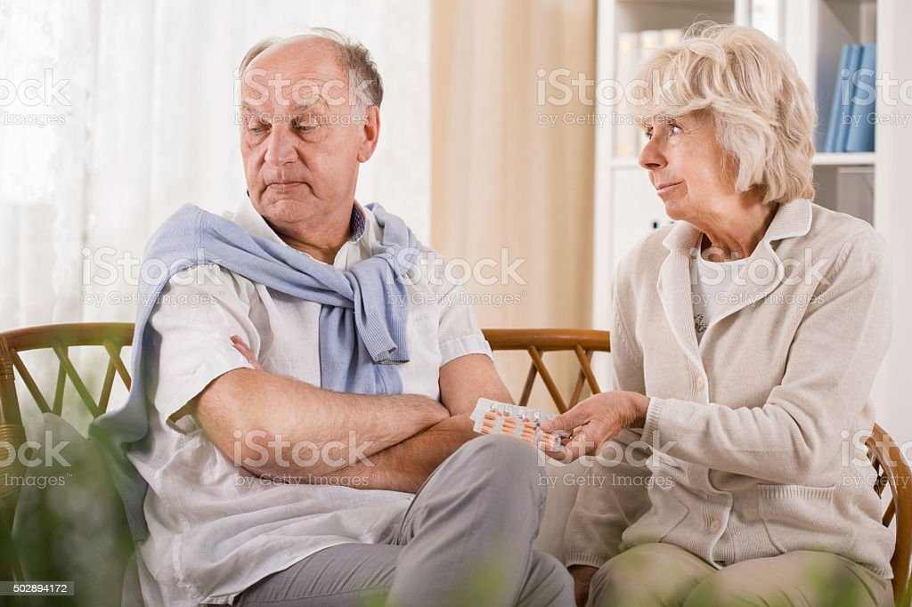 Man doesn't want to take pills stock photo