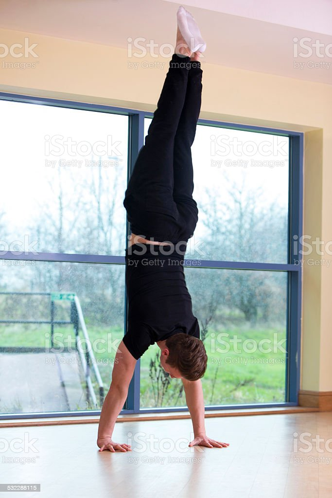 Man Doing A Hand Stand stock photo