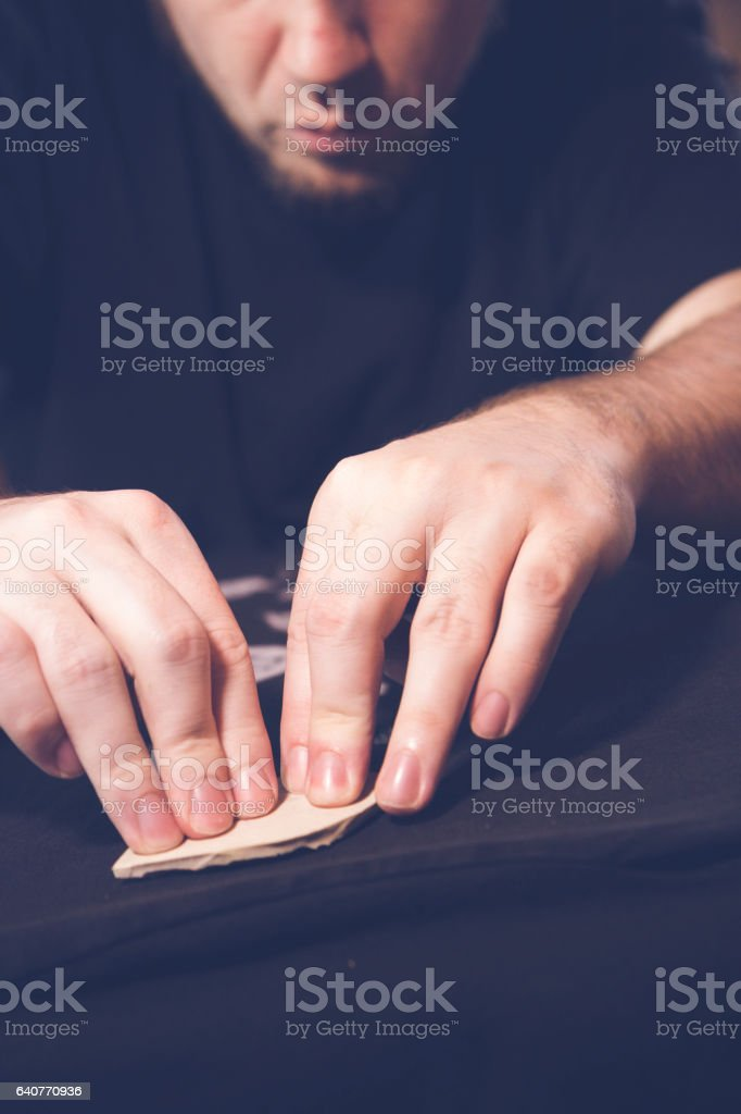 Man doing a linocut carving stock photo
