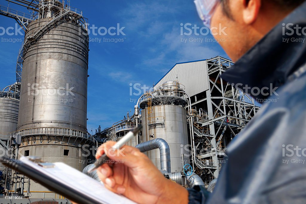 Man doing a safety check at a power plant stock photo