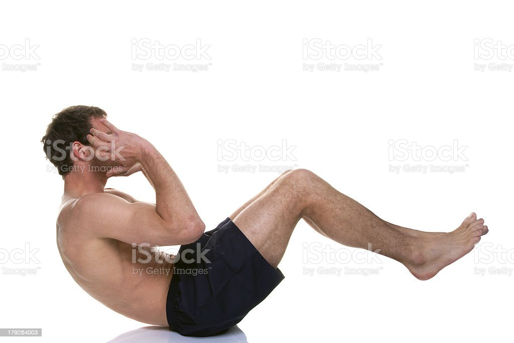 Man doing a sit up stomach crunch royalty-free stock photo