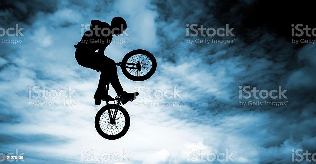 Man doing an jump with a bmx bike. stock photo