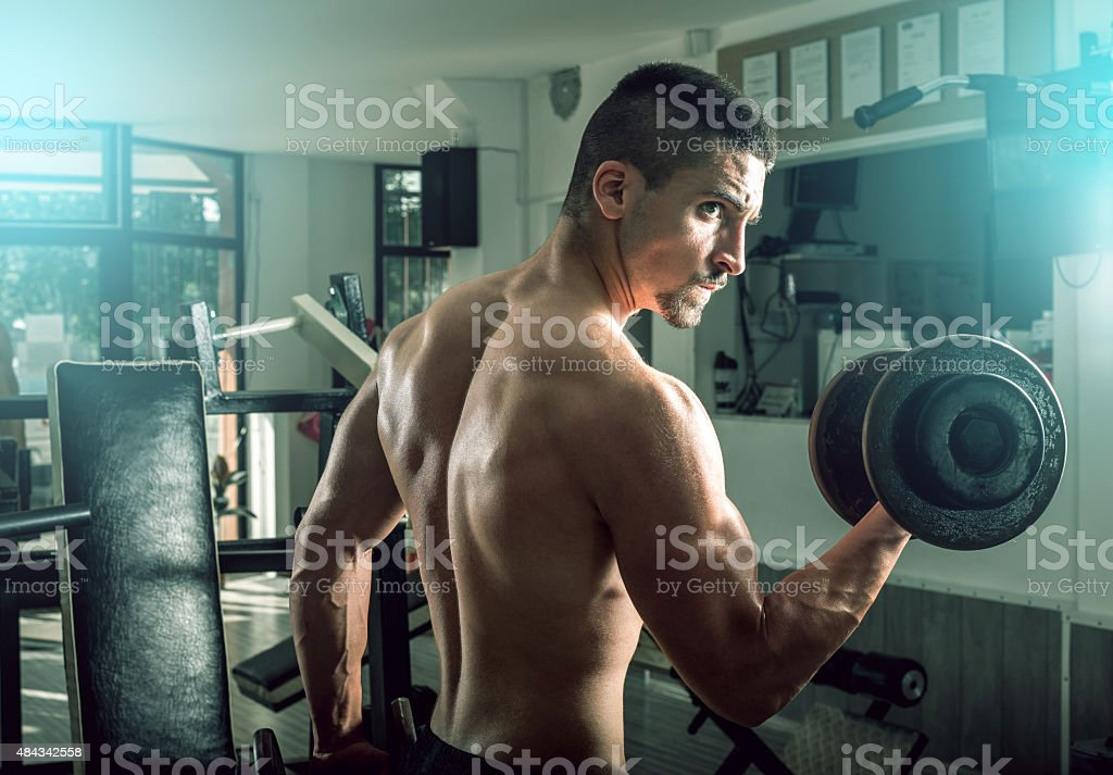 Man doing biceps curls stock photo