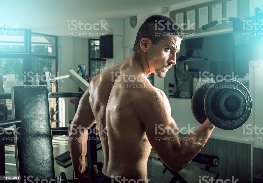 Man doing biceps curls stock photo