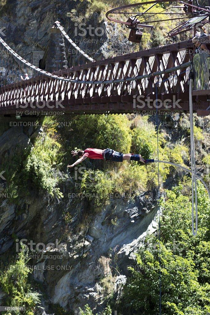 Man Doing Bungee Jumping from Kawarau Bridge, Queenstown, New Zealand stock photo