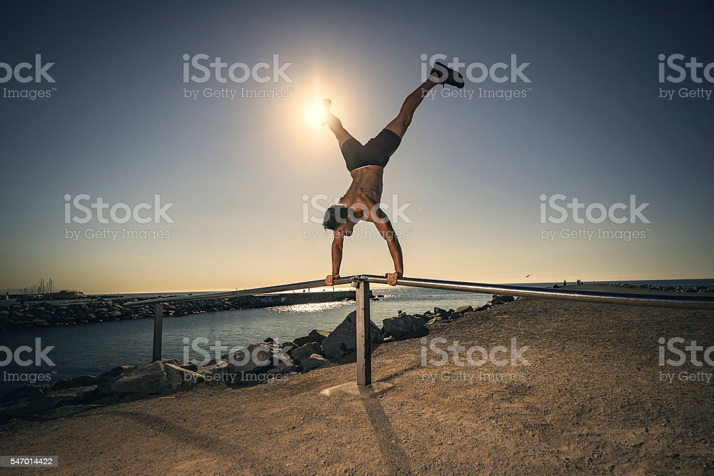 Man doing calisthenics exercises stock photo