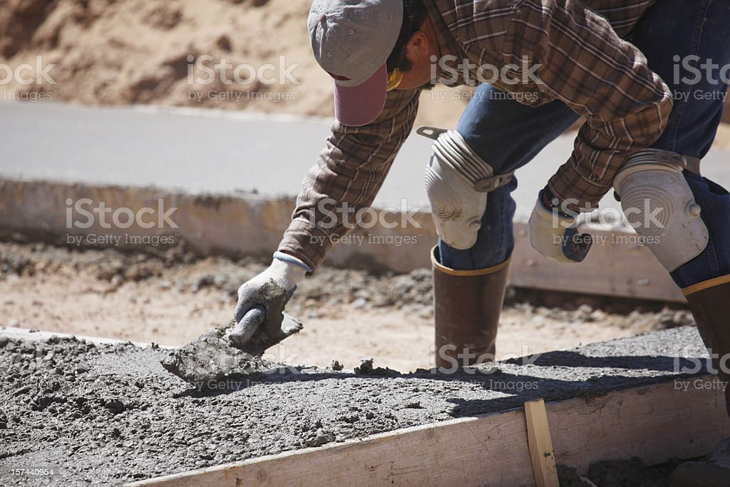 Man Doing Concrete Work stock photo