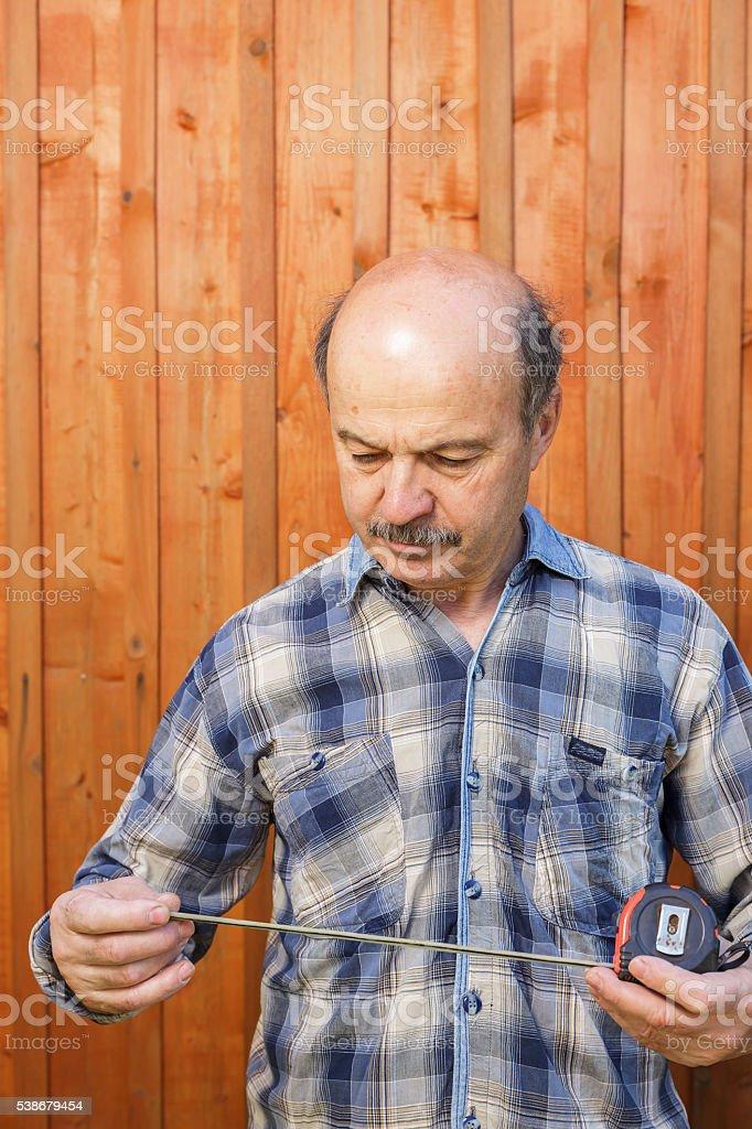 Man doing construction measurements. stock photo