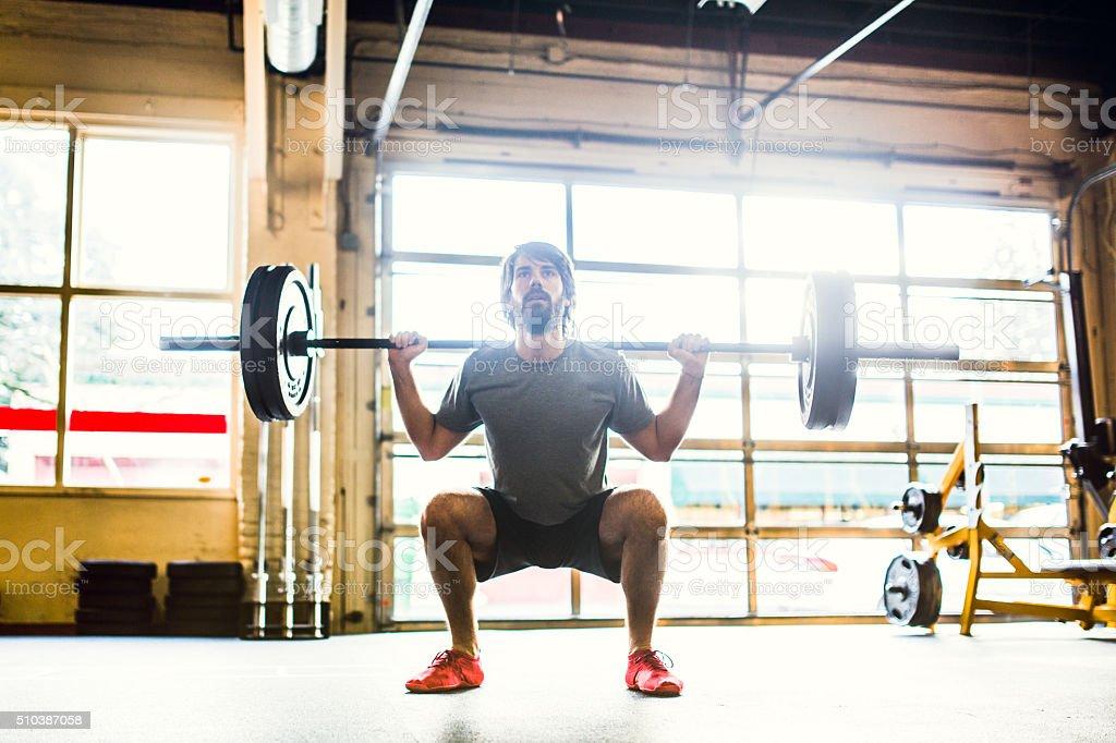 Man Doing Cross Training Workout stock photo