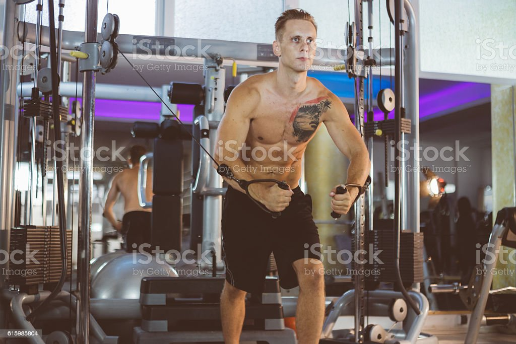 Man doing crossover chest workout stock photo