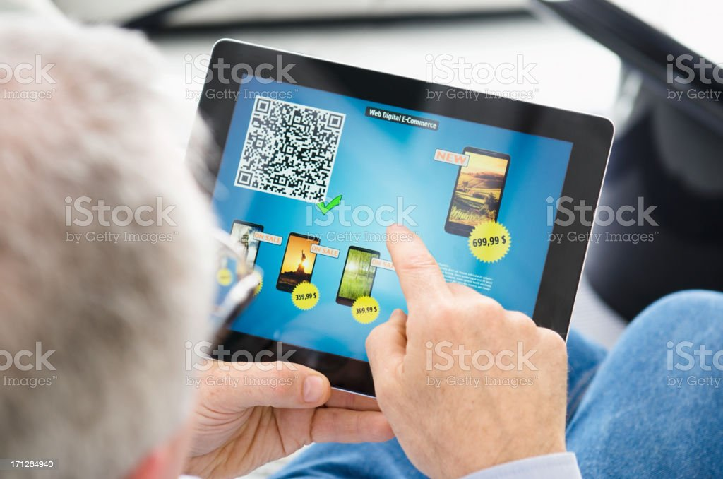 Man doing e-commerce of a new smatphone with digital tablet royalty-free stock photo