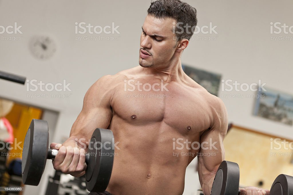 Man doing exercise at the gymnasium royalty-free stock photo