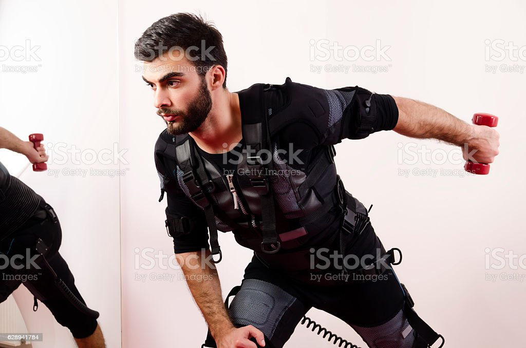 Man doing exercise for triceps on ems stock photo
