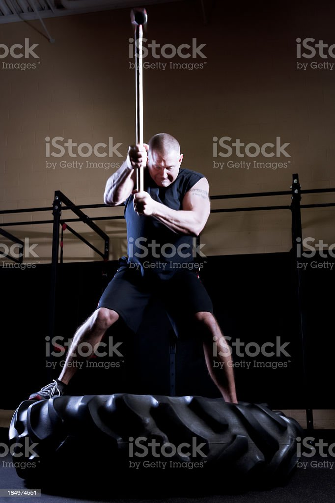 Man Doing Crossfit with Sledgehammer stock photo