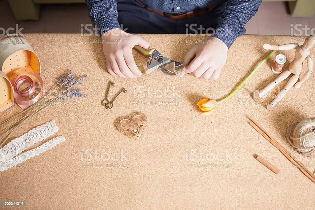 Man doing handmade gift for his beloved wife or girlfriend stock photo