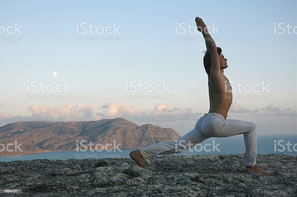 Man doing Hatha-yoga virabhadrasana royalty-free stock photo