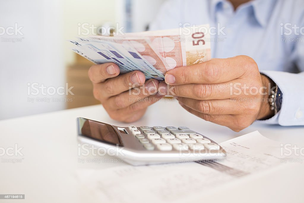 Man doing his accounting, financial adviser working stock photo