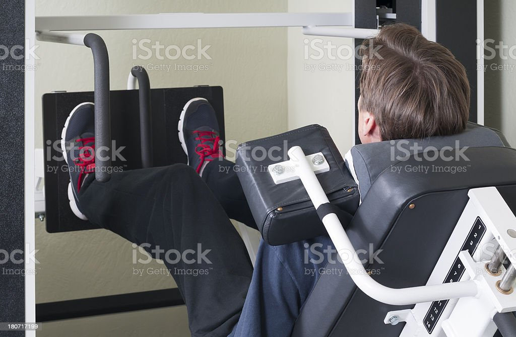 Man Doing Leg Presses royalty-free stock photo