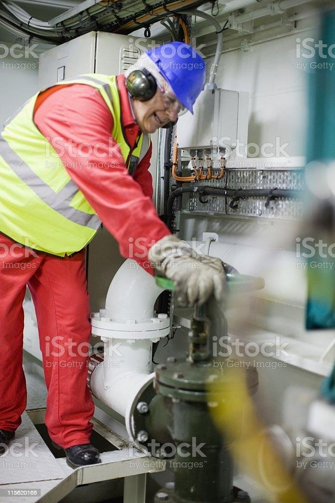 Man doing maintenance works stock photo