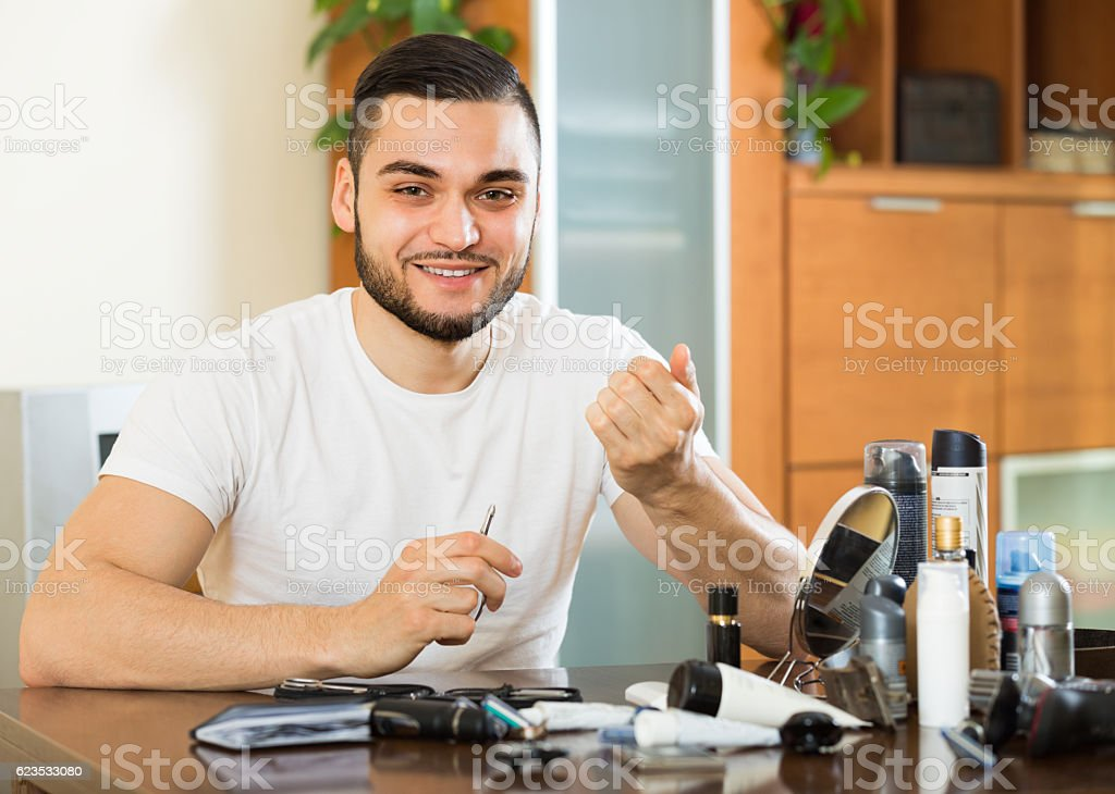 Man doing manicure at home stock photo